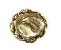 A gold mourning brooch,
