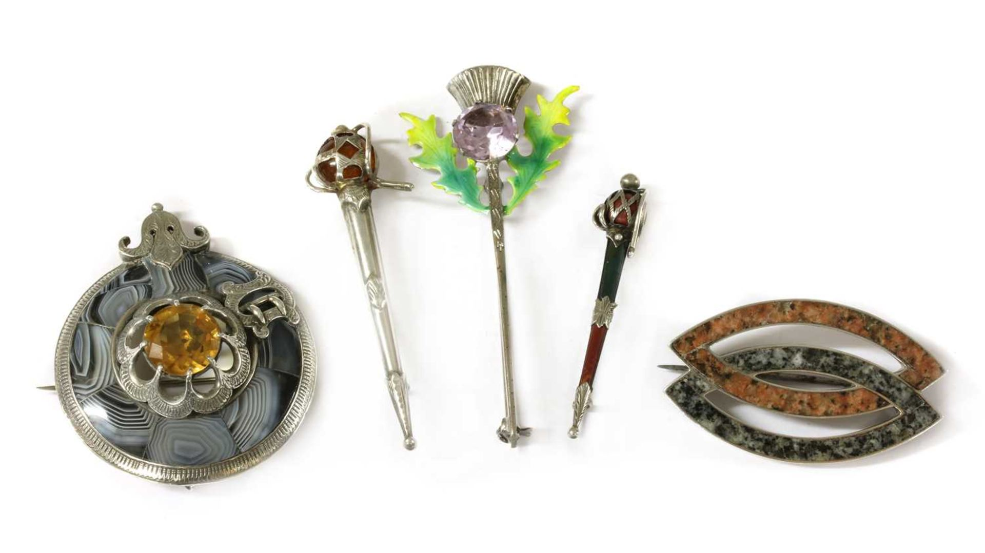 A quantity of Scottish silver brooches,