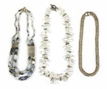 A contemporary silver two row graduated dendritic agate necklace,