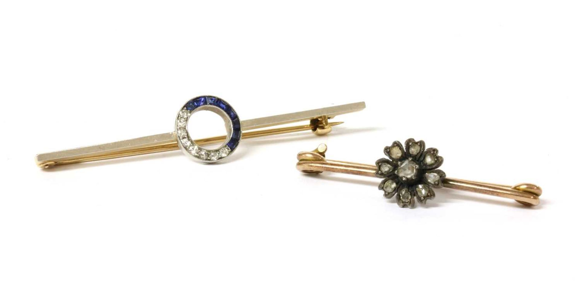 A diamond and sapphire bar brooch,