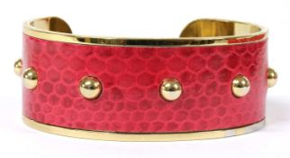 A gold plated Aspinal of London lizard skin torque bangle,