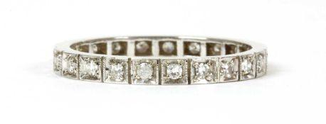 A white gold diamond full eternity ring,