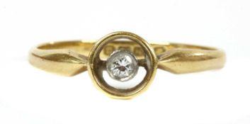 An 18ct gold single stone diamond ring, c.1920,