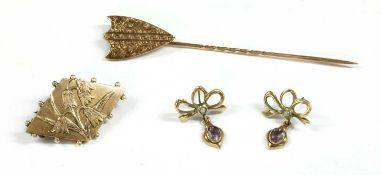 A gold shield form stick pin,