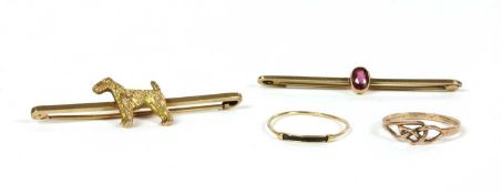 A gold dog bar brooch,