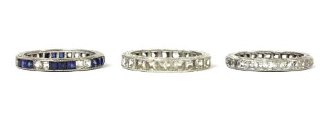 Three silver paste set full eternity rings,