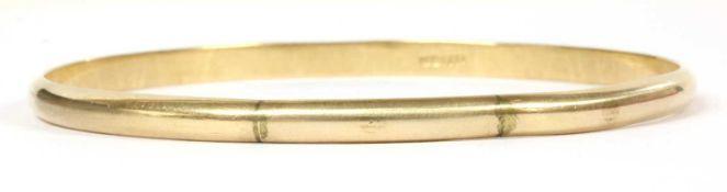 A plain gold D section bangle,