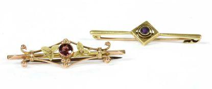 An Edwardian gold amethyst bar brooch,