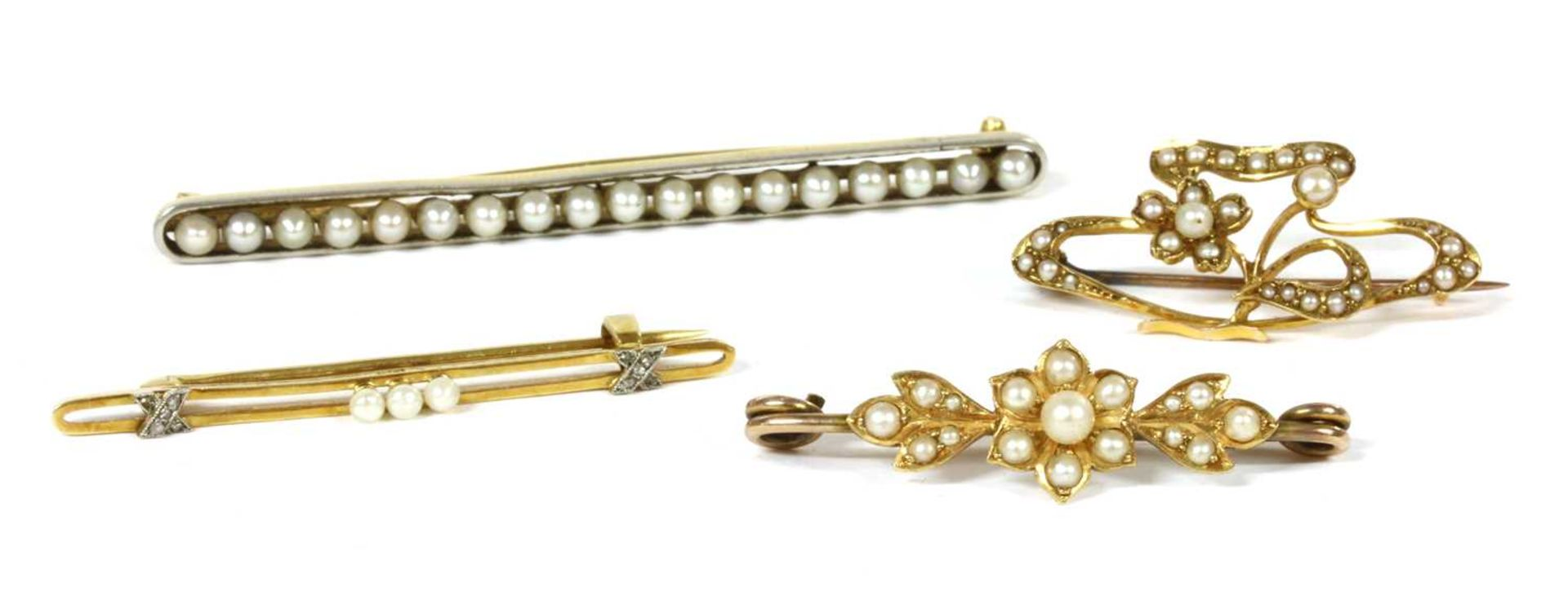 A platinum and gold pearl bar brooch,