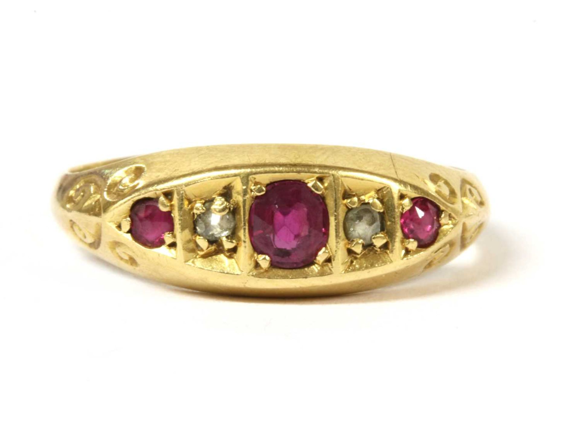 An 18ct gold five stone ruby and diamond ring,
