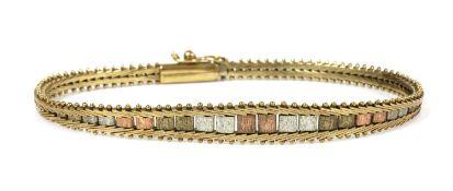A 9ct three colour gold bracelet,