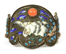 A Chinese silver gilt coral and enamel hinged bangle, c.1930,