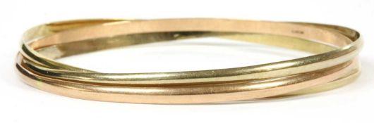 A three band three colour gold bangle,