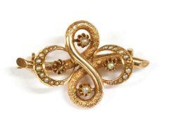 A gold split pearl brooch,