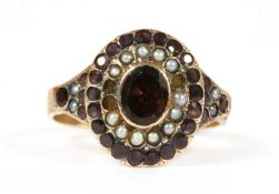 A Victorian gold garnet and split pearl cluster,