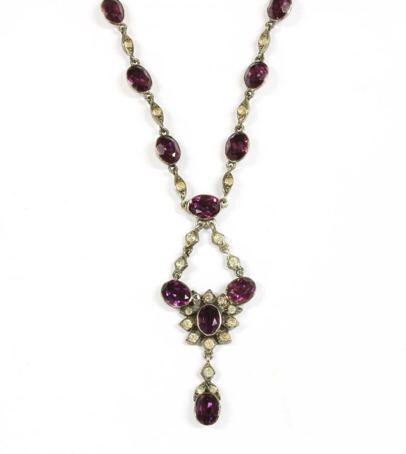 An Edwardian silver purple and white paste pendant,
