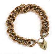 A gold hollow curb link bracelet,