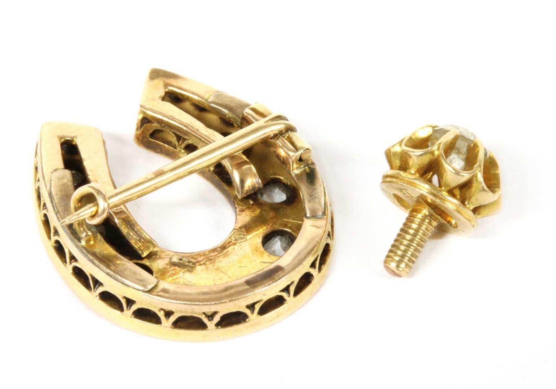 A gold diamond horseshoe brooch, - Bild 2 aus 2