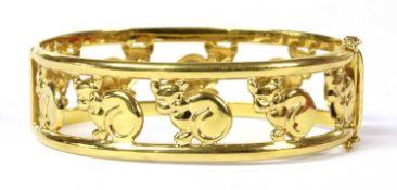 An Italian hinged oval openwork cat motif bangle,