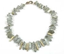 A contemporary silver and coated quartz crystal necklace,