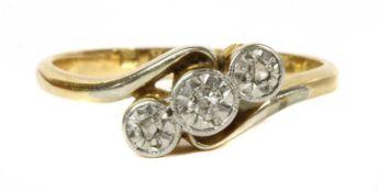 A gold three stone diamond ring, c.1925,