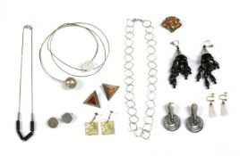 A collection of contemporary silver jewellery,