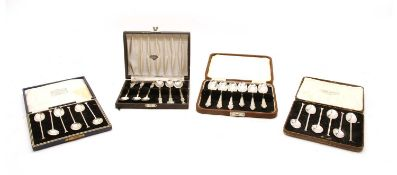 A collection of cased silver teaspoons,