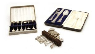 A cased three piece silver christening set,