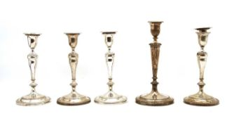 A set of four silver plated candlesticks,