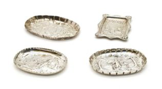 A Victorian silver pin dish with embossed landscape scene,