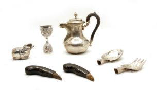 A collection of white metal items