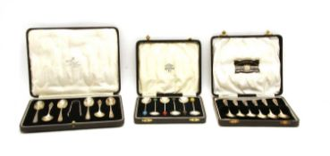 Three silver cased six pieced coffee spoon sets,