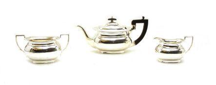 A silver three piece tea set,