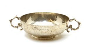 A silver planished twin handled bowl,