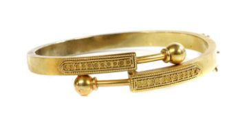 A Victorian gold, Archaeological Revival, Etruscan-style crossover hinged bangle, c.1870,