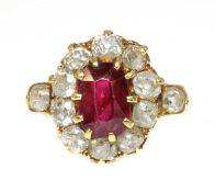 A late Victorian ruby and diamond oval cluster ring,