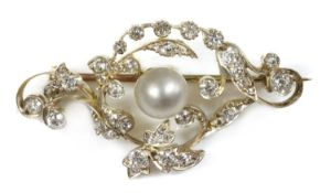 A late Victorian pearl and diamond scrolling brooch,