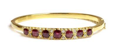 A ruby and diamond hinged bangle,