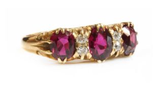 A seven stone ruby and diamond carved head ring,