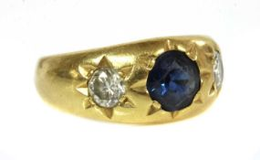 A three stone sapphire and diamond gypsy ring,