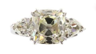 An 18ct white gold three stone diamond ring,