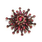 A garnet set star brooch/pendant, c.1800,