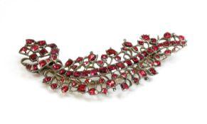 A foil-backed flat cut garnet brooch,