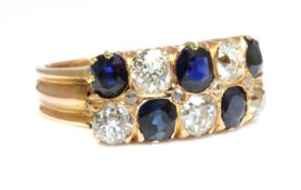 A rose gold two row sapphire and diamond ring, c.1910,