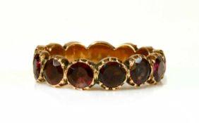 A Georgian foil-backed flat cut garnet eternity-style ring,
