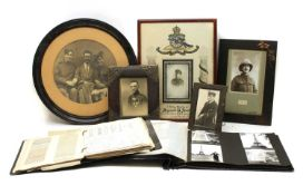 A quantity of framed WWI photographs of soldiers and fretwork search light scene,