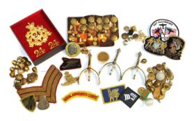 Two boxes of brass military buttons,