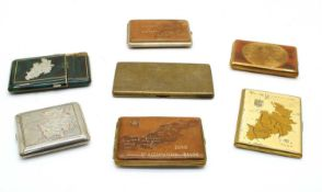 A collection of seven 1940s commercially manufactured cigarette cases,