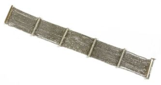 An 18ct white gold diamond set bracelet,