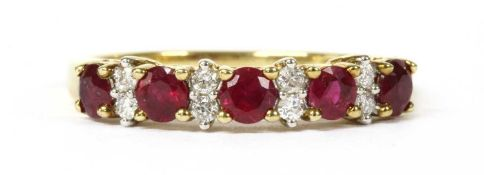 A gold ruby and diamond half eternity ring,